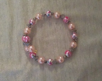 Pink and Silver Beaded Wraparound Bracelet, with a small hint of blue from one of the pink beads splatter design