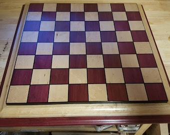 Chessboard made from purple heart,birdseye maple,and gaboon ebony with 2 and a quarter inch squares
