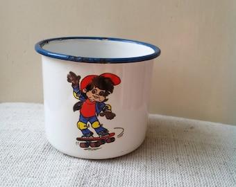 Kitchenalia - vintage white enamel cup mug  with skateboarding boy blue margin- enamelware
