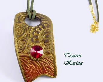 a pendant made of polymer clay with a relief pattern and a red crystal Rivoli, a pendant on a suede lace as a gift to a mother