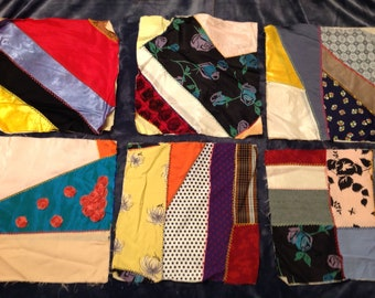 Twenty six handstitched and hand embroidered vintage crazy quilt squares