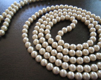 """Ivory faux pearl 1920's long beaded necklace measures 60"""" long"""