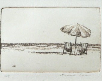 original etching and aquatint of deck chairs and a parasol on the beach