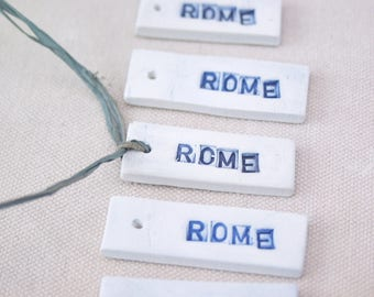Rome. Fired Clay Tags That Say Rome. Set of Five. Hand Made. Recycled Clay.  With Blue Letters.