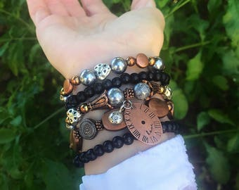 MR. ROBOTO... 5 strand black and mixed metals bracelet set with clock charm