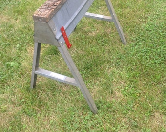 Sawhook. Keep your saw handy right on your sawhorse. Hang it on your sawhorse to have your saw inches from your hand.