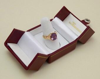 14k Rose Gold and Platinum Ring - (1) Violet Spinel, wt. 3.80 cts. - (2) Blue Diamonds set in Platinum, wt. .22 cts.