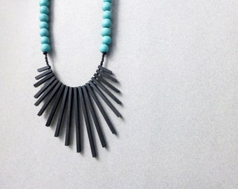 tribal geometric necklace , black sticks and turquoise beads , contemporary jewelry