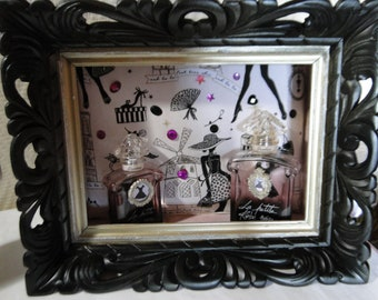 creating perfume bottle framed little black dress