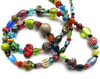 Long colourful mix of glass beads, paper beads, wire, ceramics,...