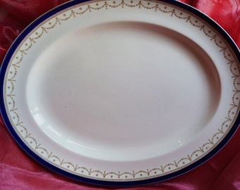 A very smart vintage Alfred Meakin 'Bleu de Roi' large serving platter, edged with bands of cobalt blue and gold swags. c. 1940