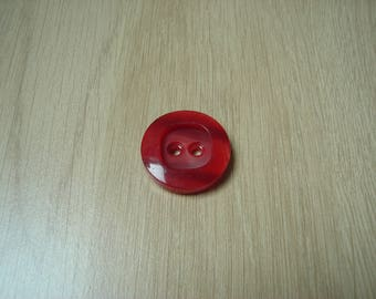 large marbled red round button
