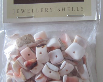 bag of 54 grams of ecru and pink pearl beads - various sizes and shape