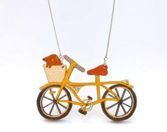 Hand Painted Dog in a Bike Basket Necklace - Yellow. Laser cut, wooden, illustration jewellery. Cute, bright, colourful, fun, animal jewelry