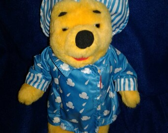 Winnie The Pooh plush 12 inches and book 1995 Poohs Colorful Rainy Day Book & Pooh!Only ever pay to ship 1 item we cover the rest stock up