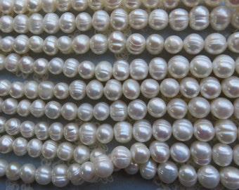 White 6mm Potato Pearls, 14 Inch Strand - Item 3300