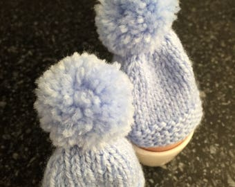 A Pair of Hand Knitted Egg Cosies - pale blue