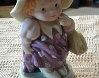 "Avon's ""Cherished Moments."" figurine"