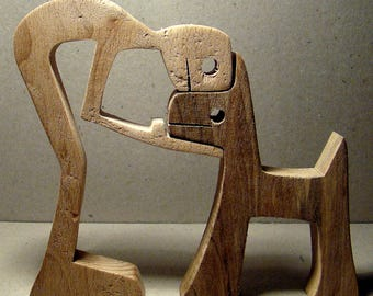 "Carving wood scalloped ""one man dog"""