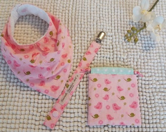 Set of birth with pink floral cotton birds and white Terry cloth.