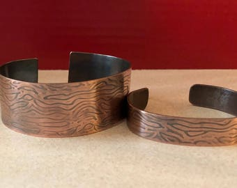 His and Hers matching antiqued copper with wood design milled into the metal.
