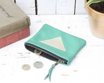Leather purse with gold triangle detail and metal zip and cotton lining