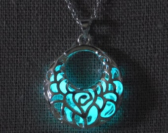 """Half-moon silver filigree pendant that glows in the dark on 18"""" silver chain"""