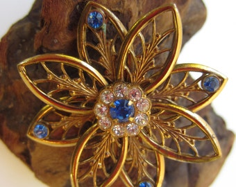 Nice Coro Gold Tone Flower Brooch with Clear and Blue Rhinstones