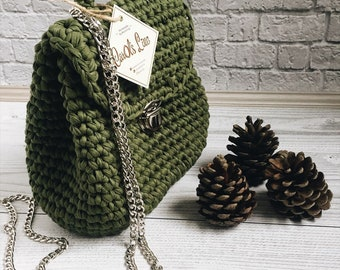 Knitted Backpack with metallic chain straps.