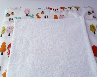 Nomad/mattress Red Riding Hood diaper changing pad.