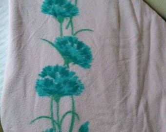 Absolutely stunning mid century twin/ full pink cotton blanket with satin binding and blue carnations.
