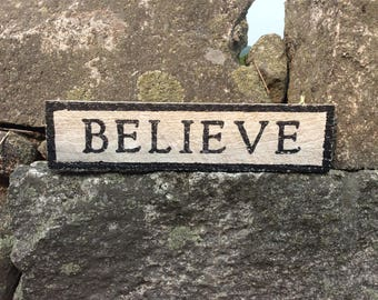 BELIEVE hemlock wood sign with rustic appearance