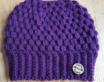 Purple messy bun beanie hat