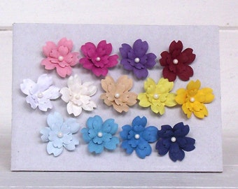 handmade paper flowers, 13 colours, made in the UK, flower embellishments, 25mm flowers, pink flowers, white flowers, blue flowers, yellow