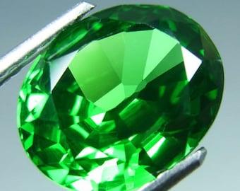 Tsavorite, Green Tsavorite,  7.60  carats, 11 mm by 9 mm by 6 mm, Oval brilliant faceted Tsavorite gemstone