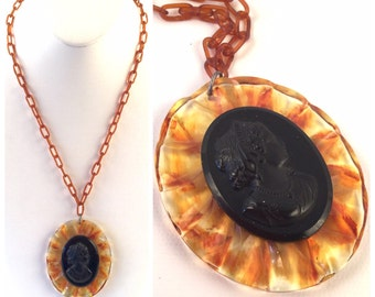 Bakelite Cameo Necklace on Celluloid Chain - Tortoise Shell Brown Scalloped Frame around Black Cameo Lady Portrait - Vintage Root Beer Chain