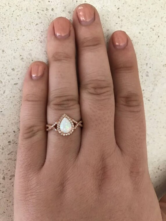 Opal Ring With Diamonds On Sides White Gold