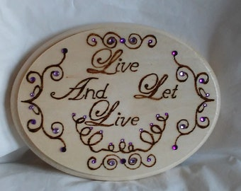 Live and Let Live wood burned plaque with recovery slogan, decorated with curvy and curling lines embellished with purple crystals