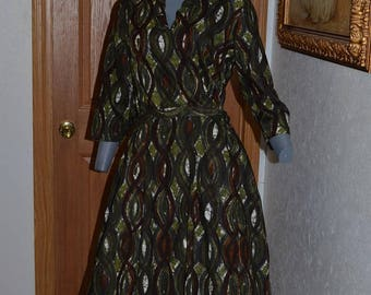 1950s day dress. Tiki Abstract print. Full A line skirt pleated with matching belt. Bust 44 VFG rockabilly
