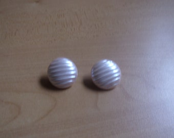vintage clip on earrings ivory colored lucite ribbed