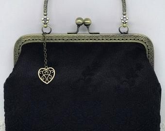 Vintage black handbag with purse