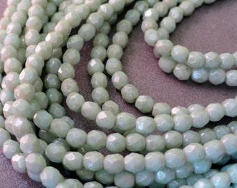 4mm Pale Green Star Dust Fire Polished Beads - Czech Glass