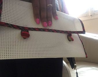 White pouch has a hole with border red madras