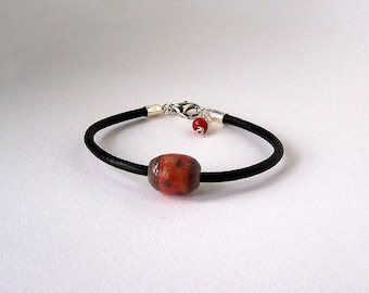 Kids red and blue stoneware and leather cord bracelet