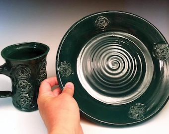 Celtic knot carved mug and matching plate in teal green