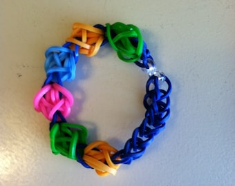 Advanced Rainbow Loom TULIP TOWER bracelet sized to fit a youth.  Really bright and colorful!