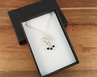 Black spinel sterling silver knot necklace