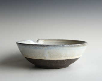 Bowl with a hole