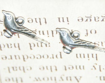 2 silver-plated 26x17x5mm swallow charms