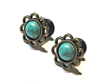 Blue turquoise flower plugs for gauged ears: 14g 1.6mm 12g 2mm 10g 2.4mm 8g 3mm 6g 4mm 4g 5mm 2g 6mm 1g 7mm 0g 8mm 00g 10mm 7/16' 11mm